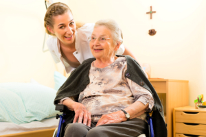 caregiver assisting old woman on the wheelchair